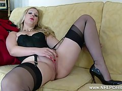 Sexy blonde lady in vintage lingerie is spreading her legs wide open and playing with her pussy