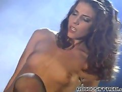 Gorgeous gal with wavy hair wears stockings and is prepared for old school riding and anal drilling