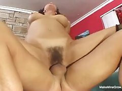 Vanessa is wearing nothing but her black stockings while having sex with her married neighbor