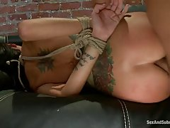 Tattooed girl is tied up and very horny and needs to get fucked in the ass
