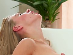 Cute blonde with long legs, Lolly is fingering her pussy and thinking about her lover