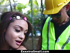 Petite teen with floewers in her hair likes to have sex with a construction worker