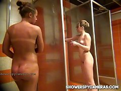 Ladies are taking a shower while a nasty guy is watching them and enjoying the view
