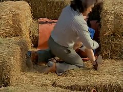 Lovely babes were making love in the hay, when their friend showed up and joined them
