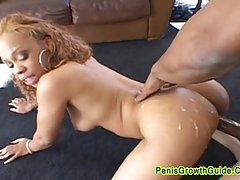 Sexy ebony girl is in a doggy style position while getting fucked by two horny guys