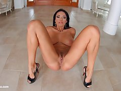 Dark haired milf in high heels, Anissa Kate is rubbing a massive dick against her big boobs