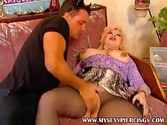 Pierced milf with big tits is getting banged on her sofa and screaming from pleasure
