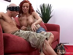 Red haired woman with big boobs is fucking a guy she likes, on the couch