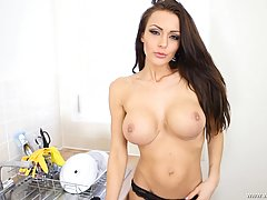 Hot milf with big boobs is posing in front of her husband, while in the kitchen