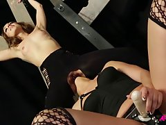 Bad slut, Dana is shoving a strap-on deep in Remy Lacroix's soft pussy, from behind