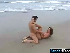 Naked, curvaceous woman is getting fucked on the beach and enjoying every second of it