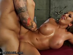 Big titted milf had one of her sexual fantasies turned into reality with her massage therapist
