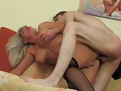 Mature bitch, in high heels likes to feel a young guy's huge sausage, in her pussy