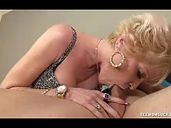 Mature blonde woman gave a nice blowjob to her neighbor, instead of his busy wife