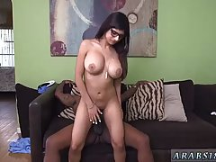 Slutty Arab brunette, Mia Khalifa is riding a big, black cock, in her living room