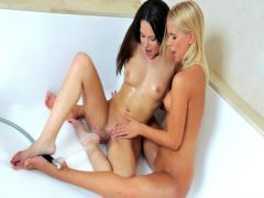 The brunette and the blonde have lesbian sex in a bathroom