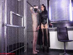 Madam in the black masturbates the friend's member through a cage
