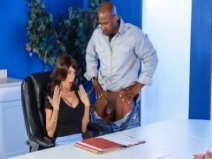 The businesswoman is flogged with the Black healthy fellow with a big dick on a workplace