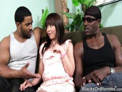 The fragile Japanese in group sex is fucked by two strong black guys