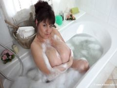 The beautiful lady with big buffers bathes in a bathroom