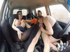 Three lovers have a good time in the car a group sex