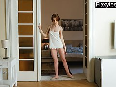 Slim, red haired babe is doing her stretching routine and thinking about her handsome lover