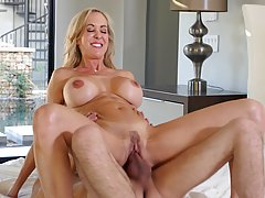 Busty blonde mom, Brandi Love is having steamy sex with a younger guy she likes