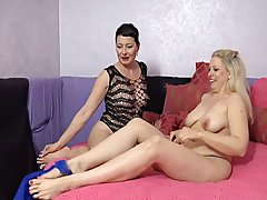 Two mature lesbians are sometimes making love with each other although they are not together