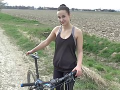 Cute brunette was riding a bike in the nature when she experienced something she could never forget
