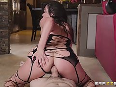 Cute brunette in fishnet is sucking and riding her horny partner's hard cock, on the sofa