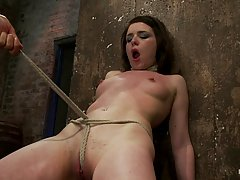 Kinky brunette is eager to experience a new session in the basement, with her girlfriend