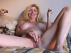Nasty blonde milf is smoking a cigaret and playing with her pussy in front of her husband