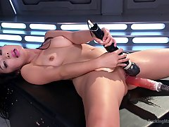 Asian brunette is not only using a fucking machine, she is also using a vibrator