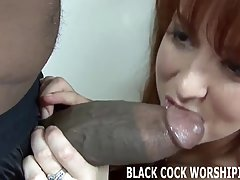 Sensual woman is sucking the biggest, black dick she has ever seen in her life